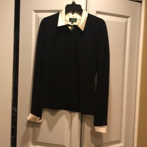 Black wool sweater with white satin trim